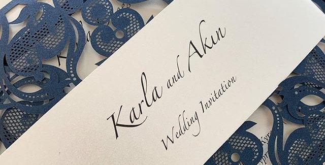 Navy laser cut wedding invitation