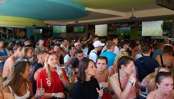English Tourists In Kavos Take A Break From Sunbathing To Show Support To Their National Team Ahead Of World Cup Match