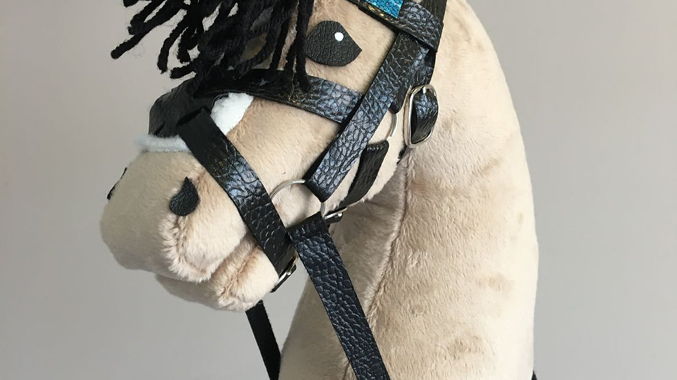 Beige pony with a black brush