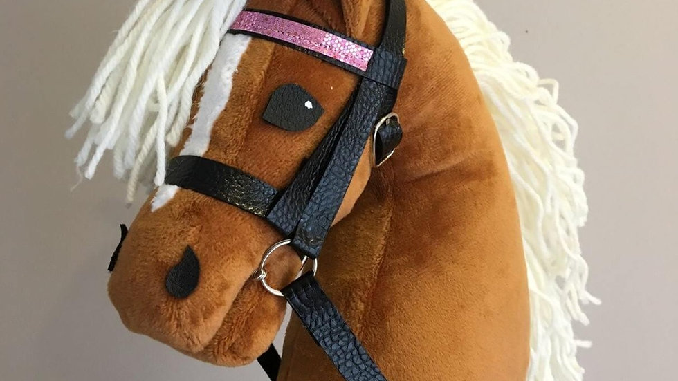 Reddish brown pony with light brush