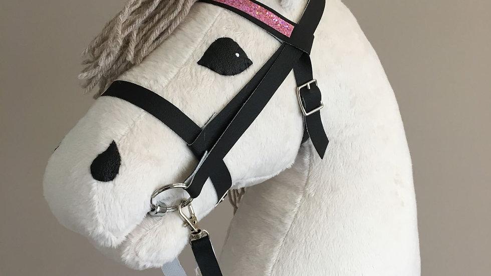 Cream-white hobby horse, with a beige brush