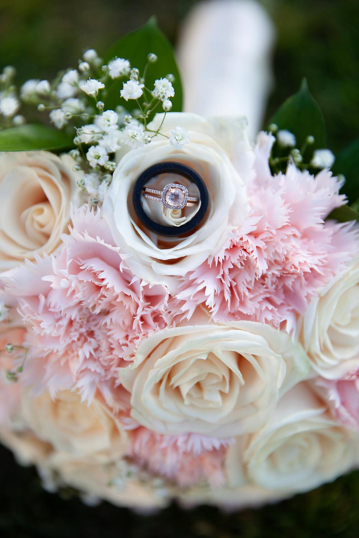 Bridal bouquet photo featuring wedding rings at a San Antonio wedding