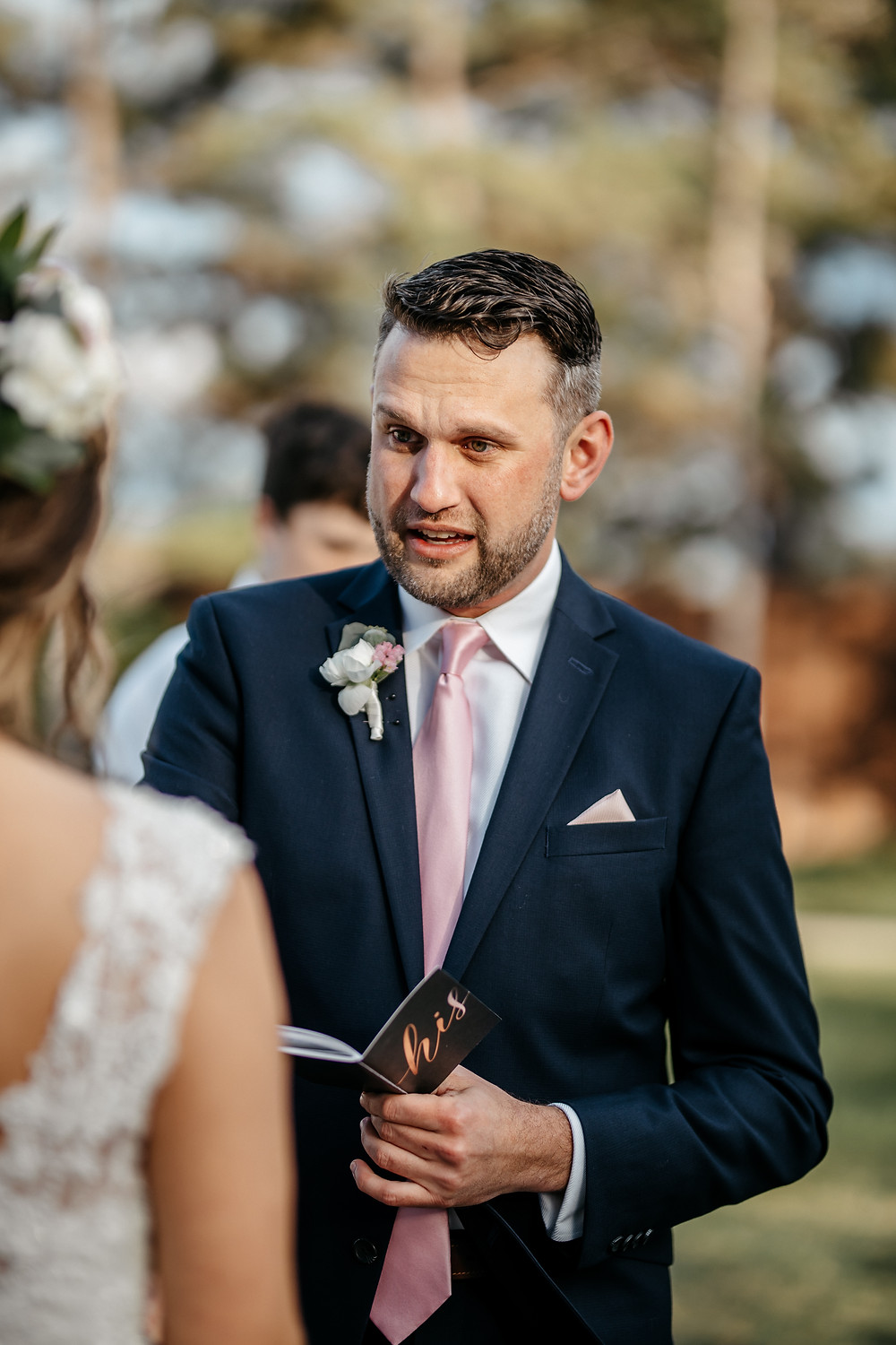 Groom shares personal wedding vows with bride in professional wedding photo by Joy Photo and Video in Texas