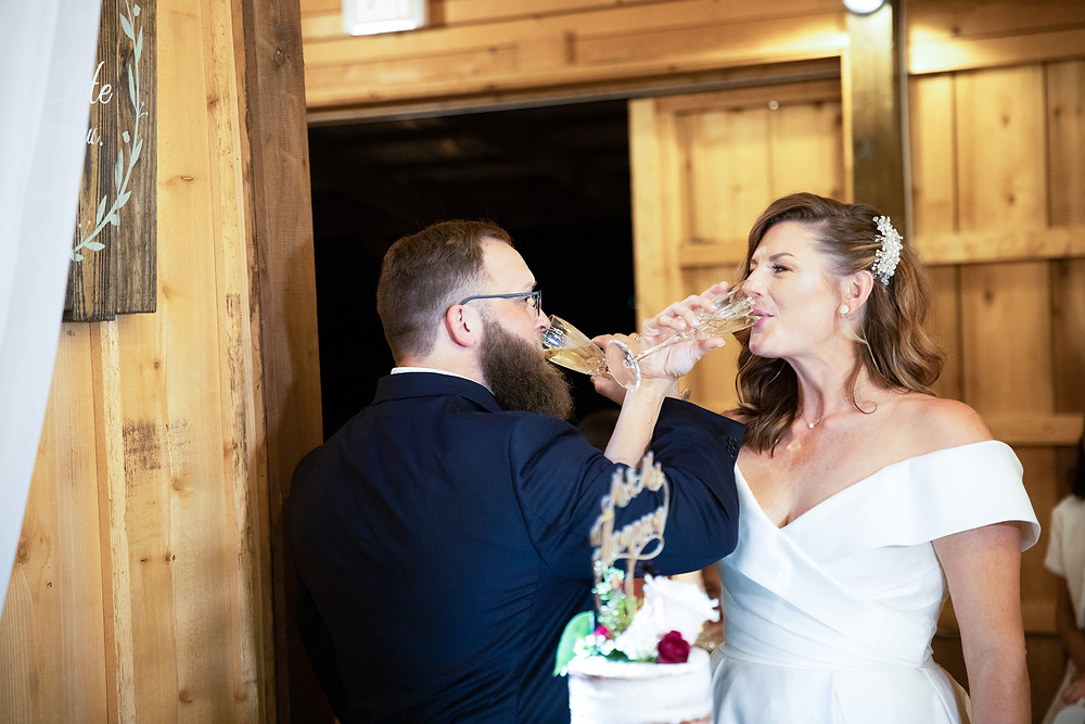 Photo of Dallas bride and groom doing a wedding toast by Joy Photo and Video.