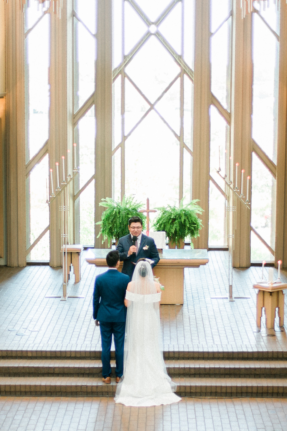 Christian couple in front of cross in religious wedding in Dallas, Texas
