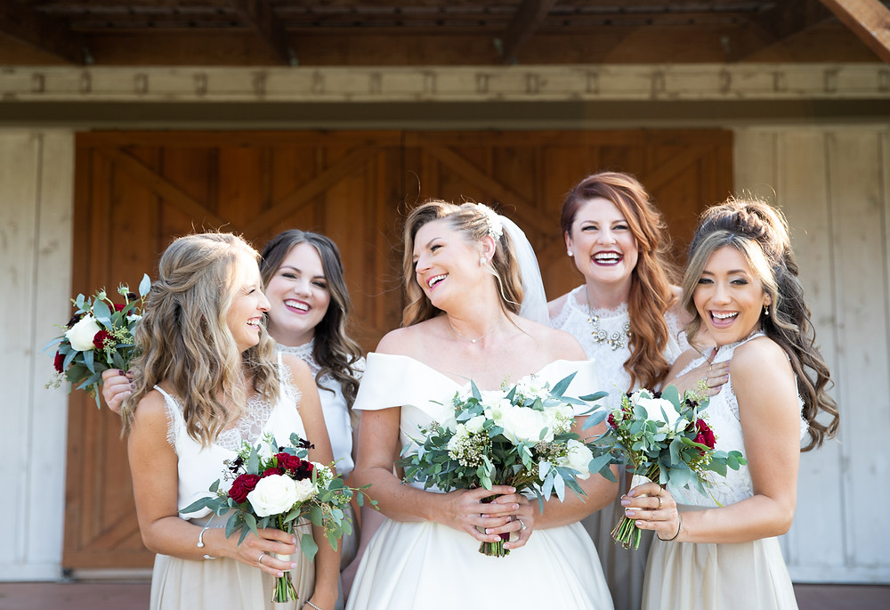 Dallas bride and her bridesmaid laughing, photo inspiration for Texas weddings.