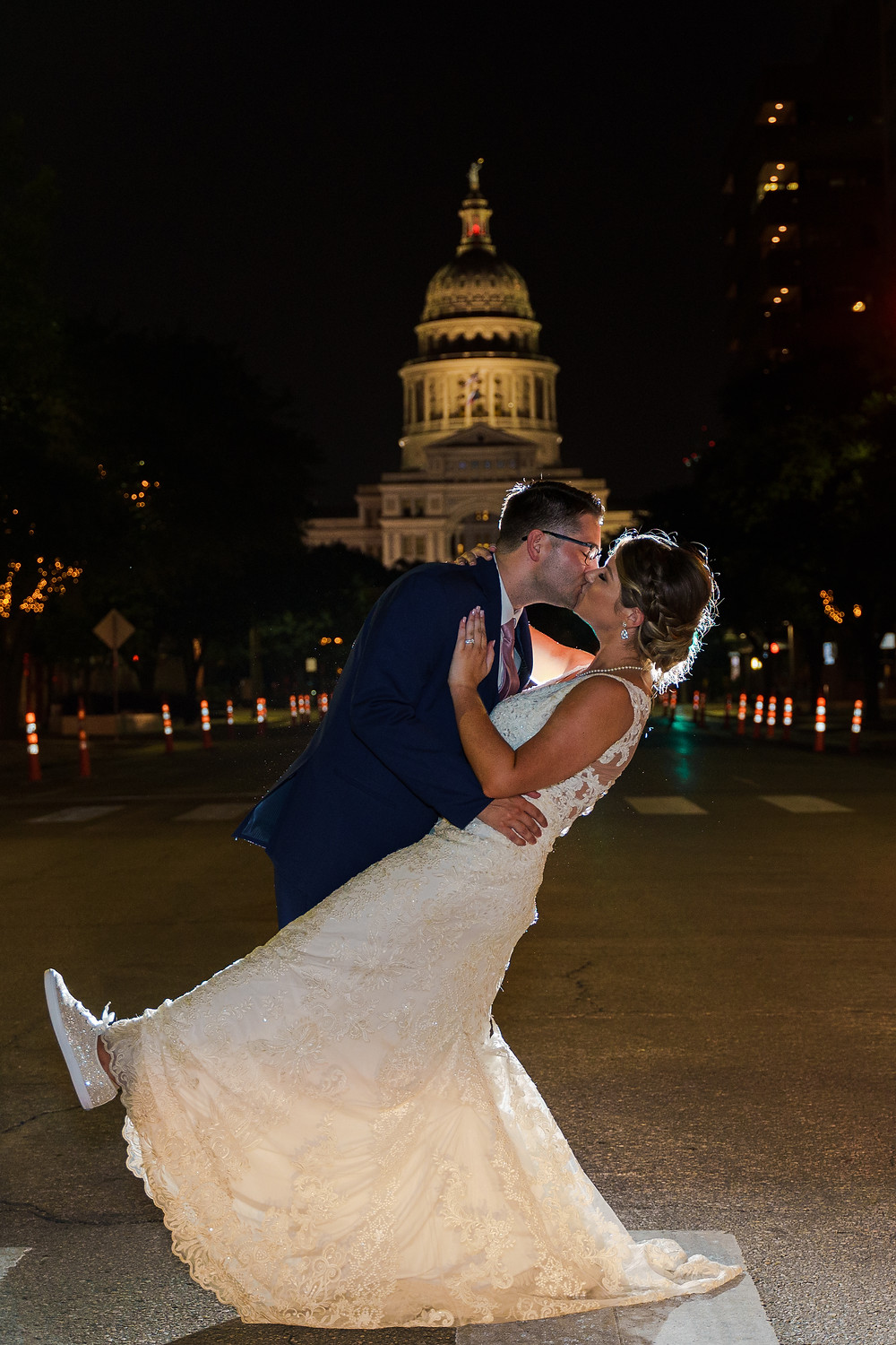 Bride and groom at State Capitol on wedding day in Austin in a photo by Joy Photo and Video