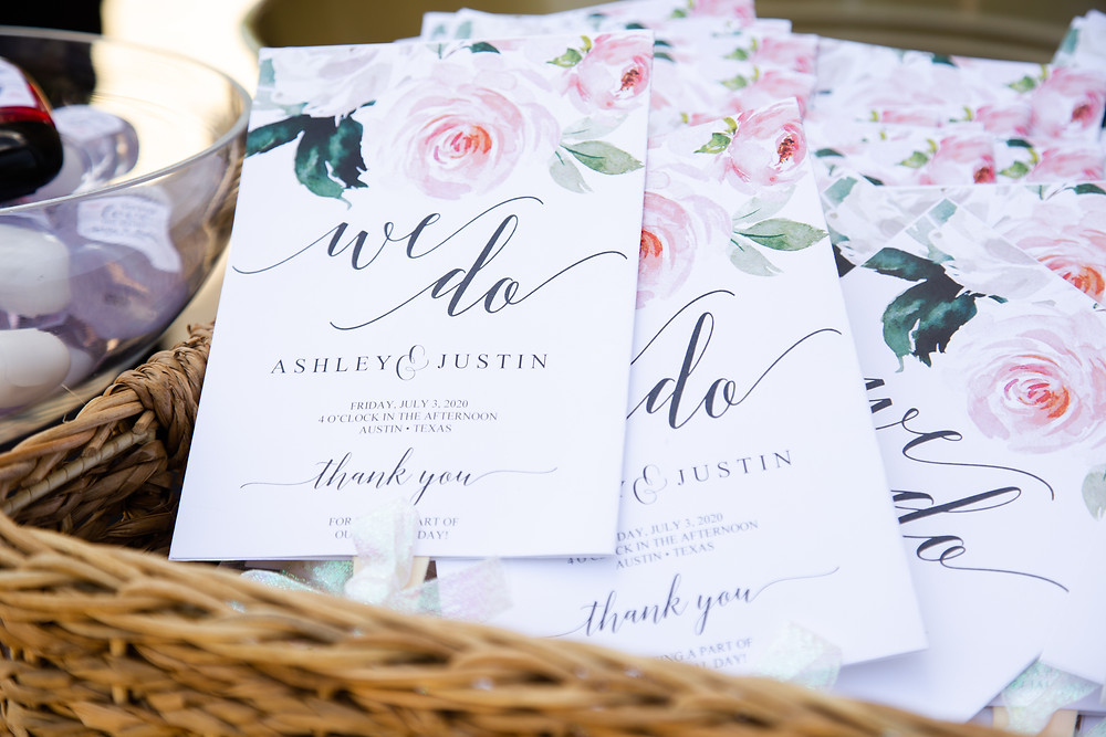 Professional wedding photography of wedding programs at real wedding in Texas.