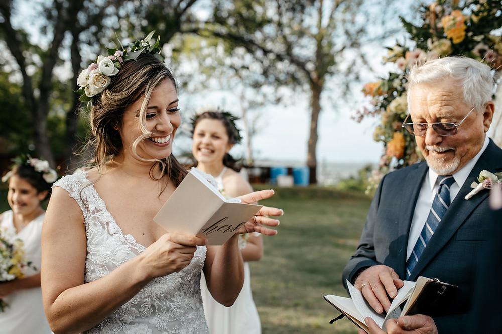 Bride exchanges personal wedding vows at wedding in Austin as shared in this wedding blog with wedding vow writing tips.