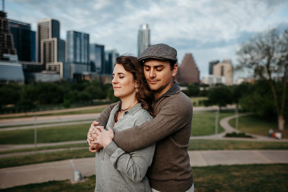 Engaged couple at engagement photoshoot overlooking the Austin city skyline