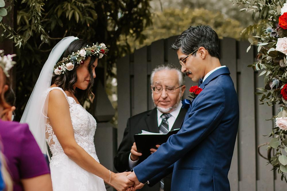Professional photo of religious wedding ceremony in Houston saying wedding prayers.