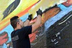 """Piero Manrique painting """"Free"""" mural"""
