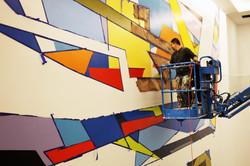 Manrique paints lobby mural in NY