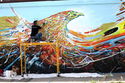 "Piero Manrique paints ""Free"" mural"