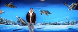 Piero Manrique with his Turtle Mural