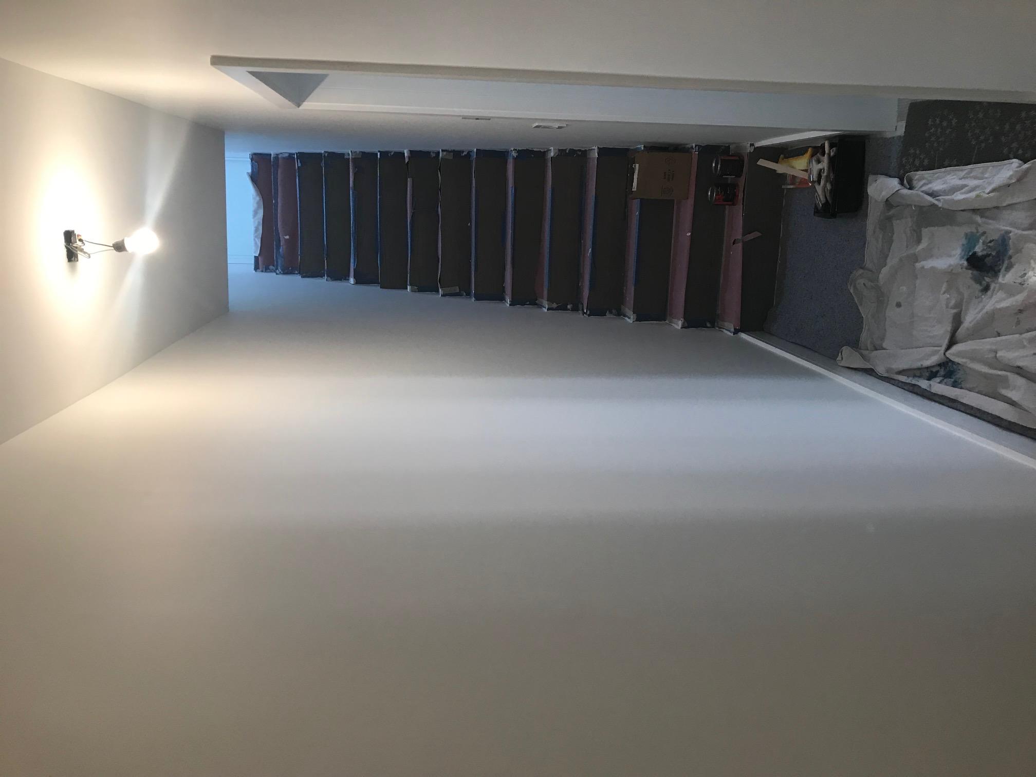 Brookly apt.  stairway before mural