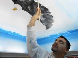 Piero Manrique Painting Eagle Mural
