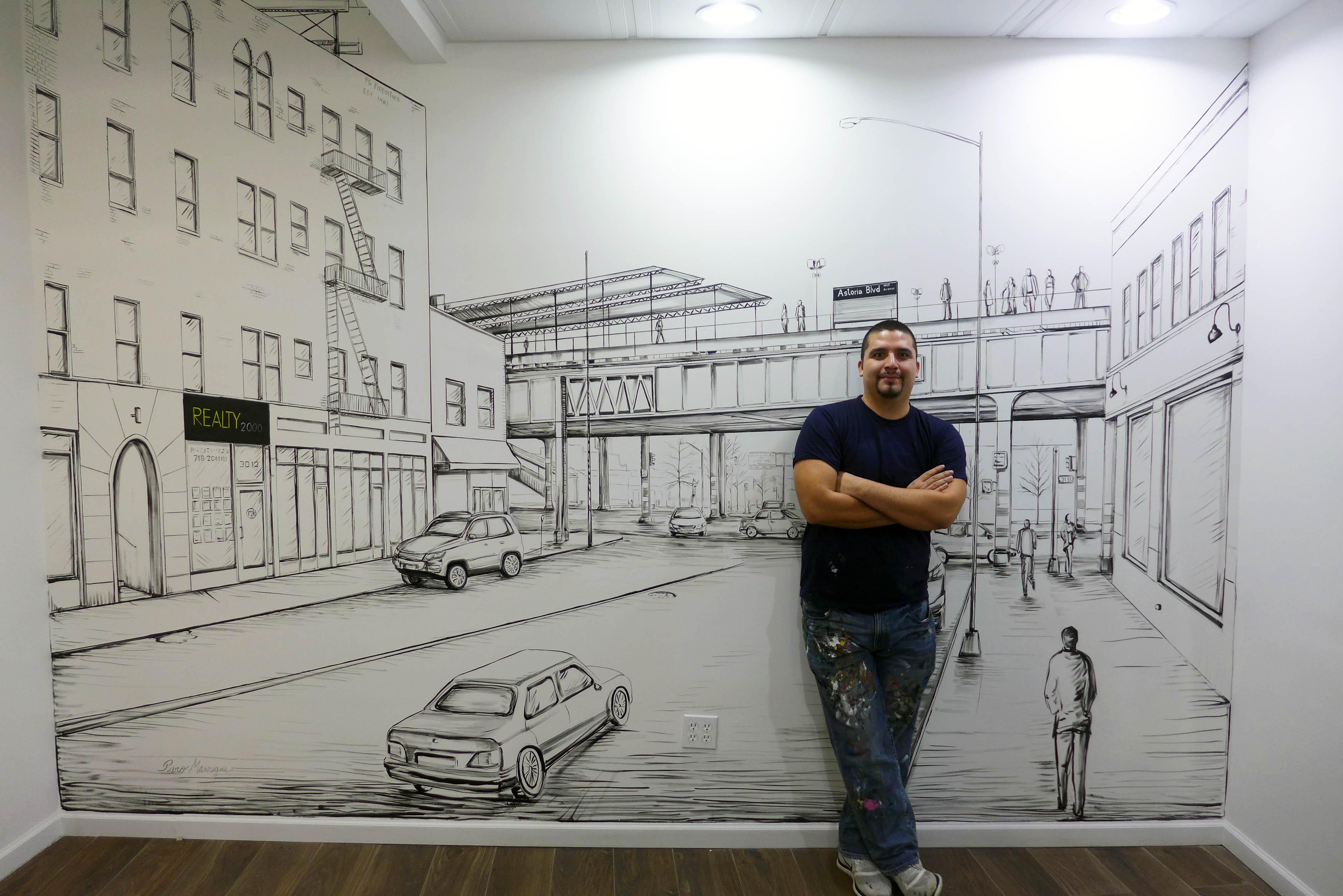 Piero Manrique in front of his mural
