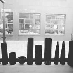 black cylinders & bottles