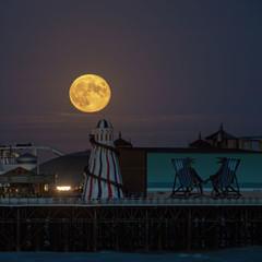 Full moon shining on Brighton Pier
