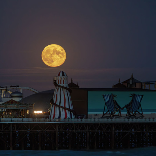 Full moon shining on Brighton Pier
