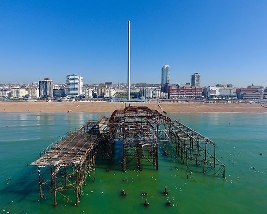Aerial views on Brighton West Pier and Hove seafront with i360 tower