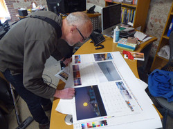 Alex Bamford checking the design