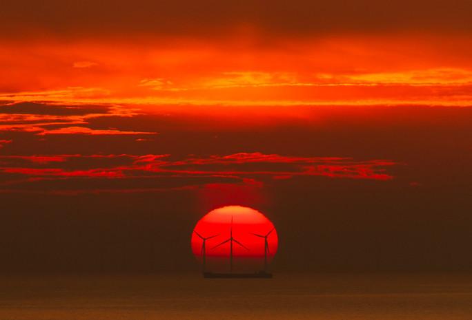 Sunset Over The Rampion Wind Farm in Brighton