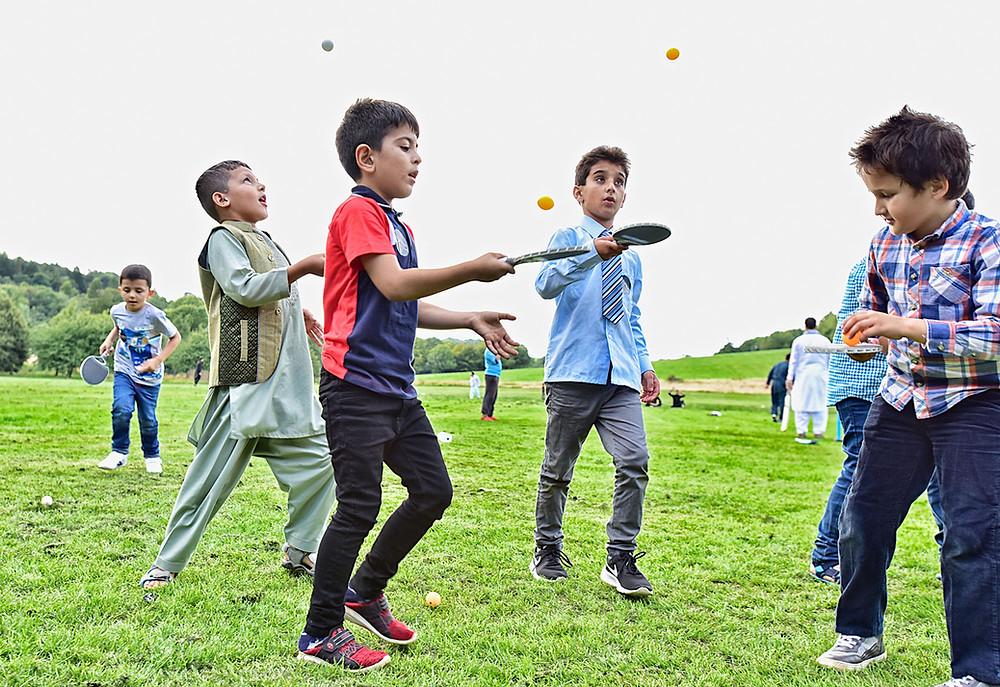 Afgan boys practicing ping pond during Eid festival in Brighton