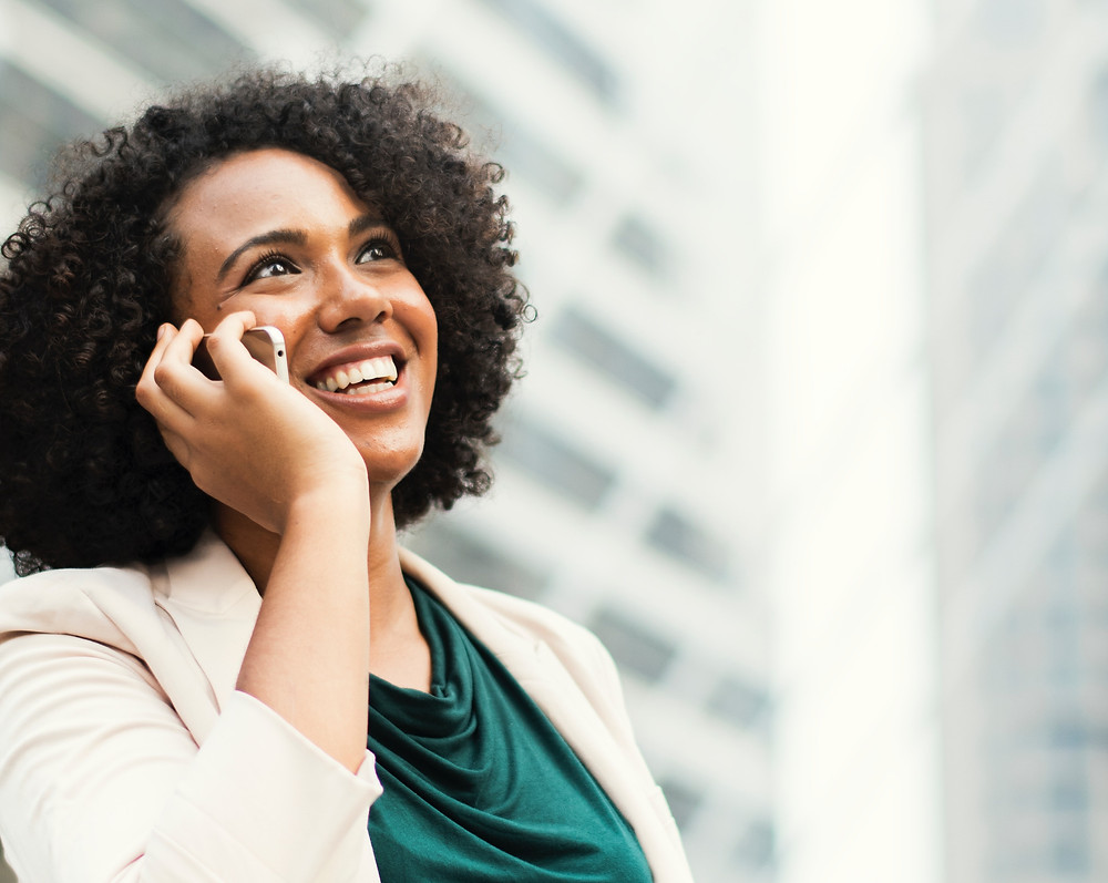 Woman smiling while talking on a smartphone