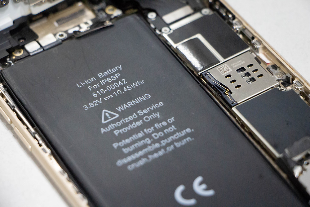 An iPhone 6S Plus battery inside view with components