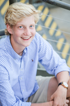 highschool guy senior photos portraits outside industrial baltimore maryland