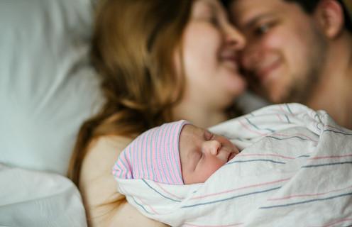 newborn baby swaddled parents hospital birth infant  maryland photographer