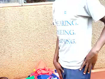 Brian Collecting Clothes in Uganda