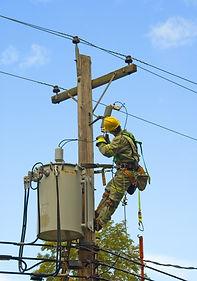 lineman working on hydroelectric pole.jp