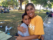 Sarah with a young refugee