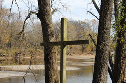 cross on river bank