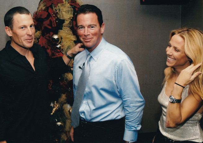August Busch IV with cyclist Lance Armstrong (left) and musician Sheryl Crowe (right)