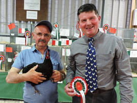 Huw Jones with his best in show pullet with Soft Feather Heavy judge, Paul Williams