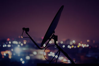 Satellite overlooking the city at night