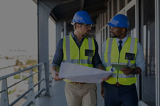 Two men walking and talking in a construction site