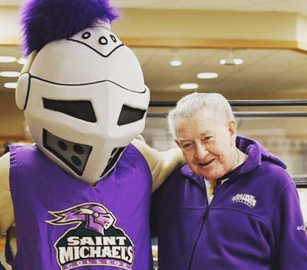 Father Ray Doherty, S.S.E. with Saint Michael's College mascot in Colchester, Vermont