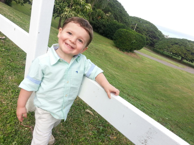 Hawaii Wedding Minister and Officiant  :  Adorable boy at Jamie & Grant's wedding