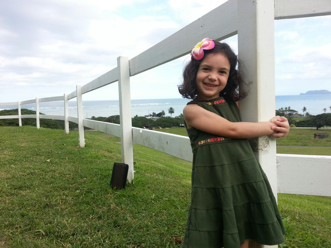 Hawaii Wedding Minister and Officiant  :  Cute Flower Girl at Kualoa Ranch