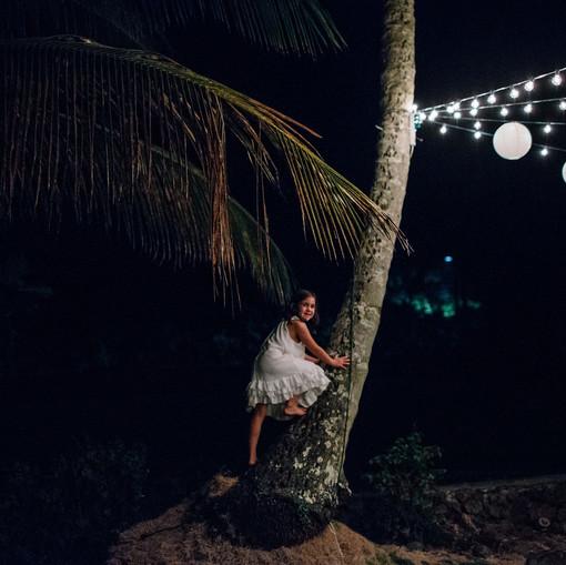 Girl climbing coconut tree