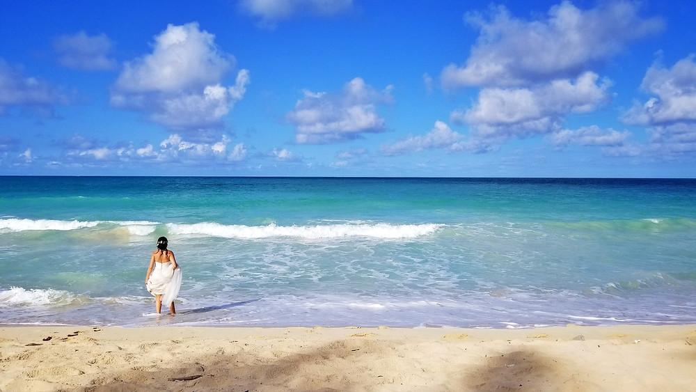 Bride splashing in Waimanalo Bay before her beach wedding in Hawaii