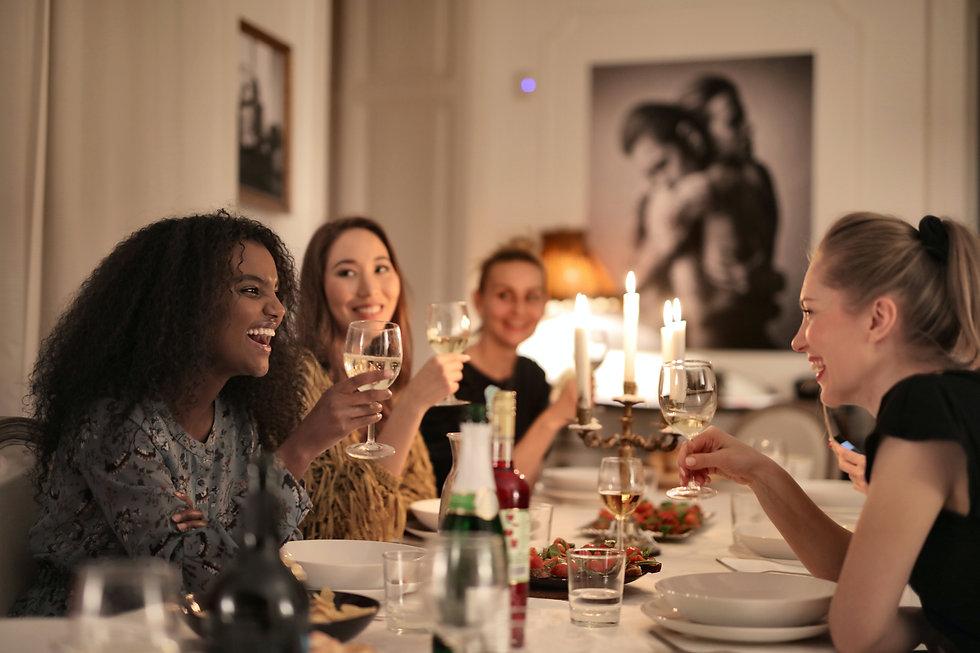 women-holding-wine-glasses-3937468.jpg