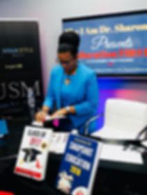 Essie McKoy signing autographs.JPG