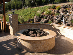 Firepit next to waterfall