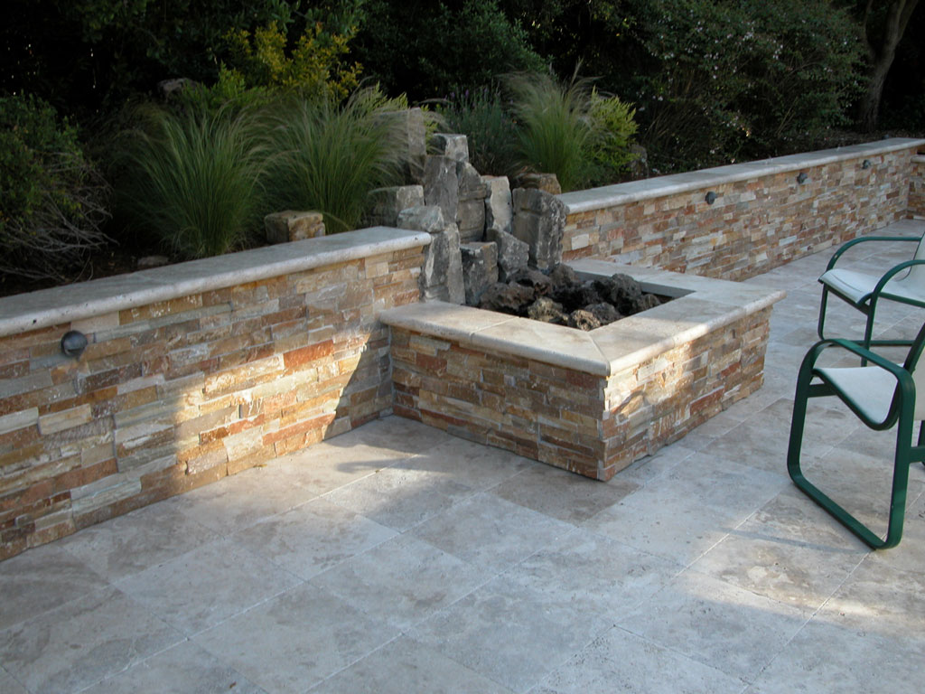Fire pit with rock wall & pavers